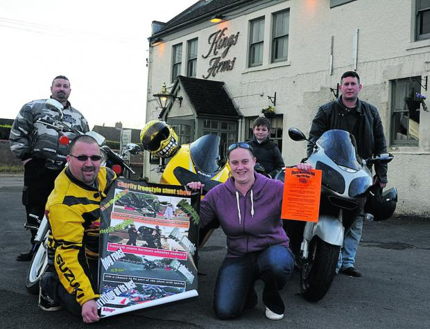 Mike and Megan Hayward display posters while from left, Martin Chalk, Mike's son Leon and  fellow biker Simon Hardwick at the Kings Arms in Hilperton