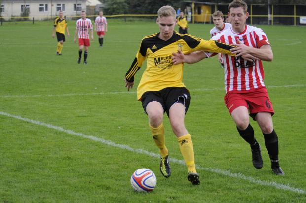 Wiltshire Times: Dan Kovacs (yellow) netted twice for Melksham Town in last night's 6-0 win against Hengorve Athletic