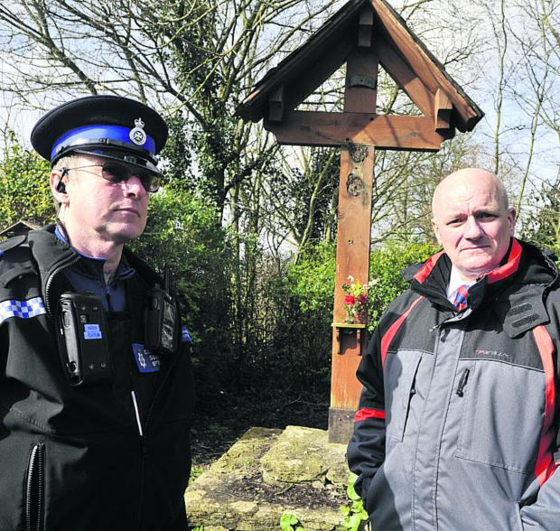 Wiltshire Times: PC Richard Gardner and PCSO Andrew Maclachlan at the Wingfield war memorial