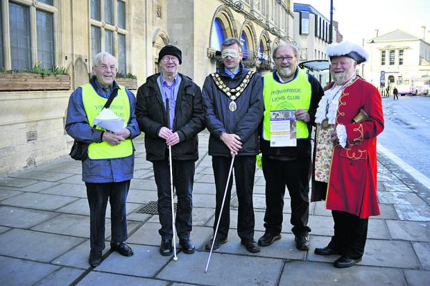 Wiltshire Times: Trowbridge mayor David Halik walked through the town centre blindfolded and partly guided by members of Trowbridge Lions Club and town crier Trevor Heeks