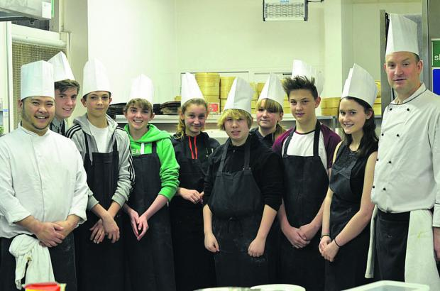 The TGI 'team' during their day of learning the cooking skills at Sampans Restaurant at the Holiday Inn, with the chefs who provided the training