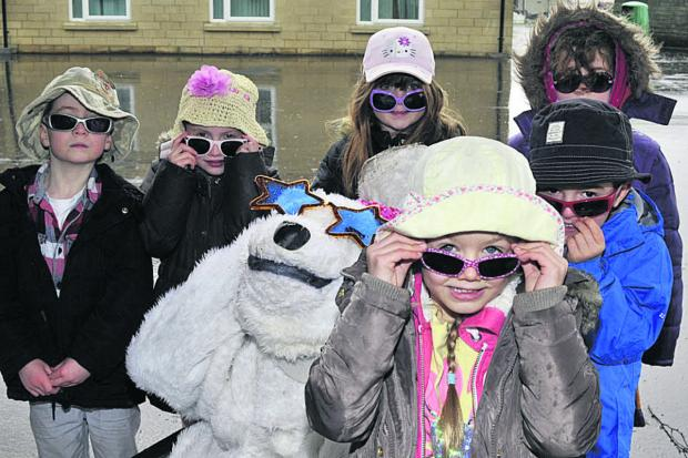 Richard Craft of Climate Friendly Bradford as Solar Polar the bear with Fitzmaurice School pupils Lydia, Thomas, Charlotte, James, Mollie and Freja