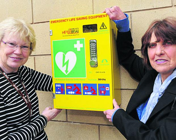Maryrose Mantle and Coun Helen Osborn with the defibrillator put in place at the Civic Centre, Trowbridge, last year. More will be provided in Wiltshire soon