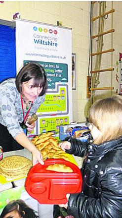 School governor Tracey Broadway hands out breakfasts at Queens Crescent School, Chippenham