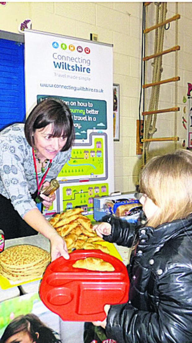 Wiltshire Times: School governor Tracey Broadway hands out breakfasts at Queens Crescent School, Chippenham