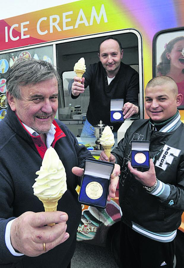 Wiltshire Times: Henry Nurkowski, front, of Hilperton, with ice cream men Mariusz Kekus and Pavel Ziadon celebrate their sweet success