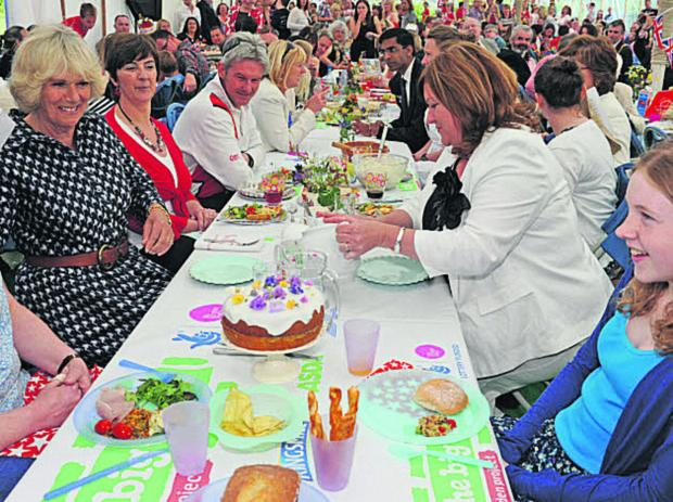 Wiltshire Times: The Duchess of Cornwall enjoys the Big Lunch at Paxcroft Mead, Trowbridge, last year