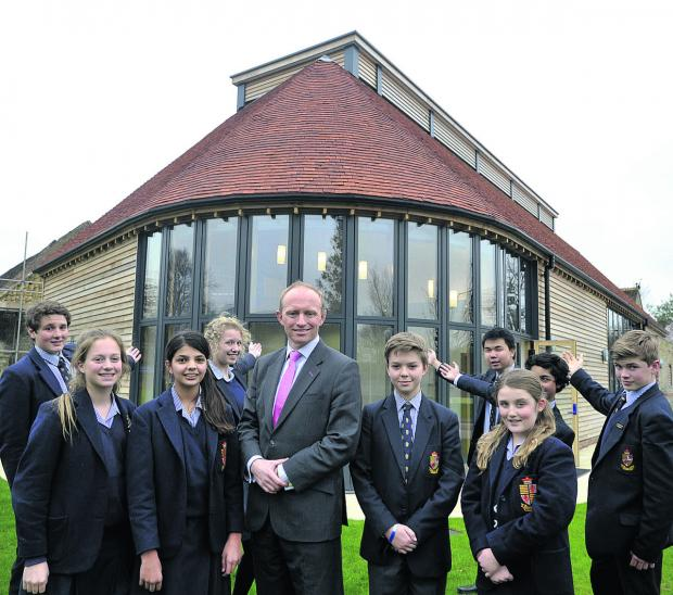 Warminster School headteacher Mark Mortimer and pupils show off their new multi-purpose hall