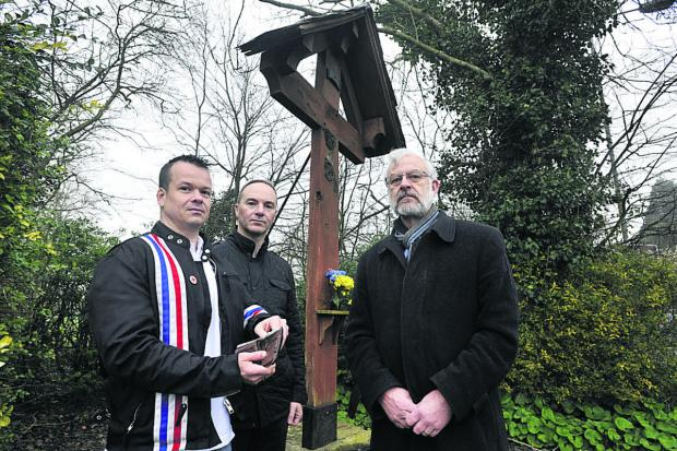 Wiltshire Times: Michael Copland-Griffiths, right, with Neil White, left,  and Dominic Hayhoe from Forces War Records who are offering a reward for the   return of the stolen statue