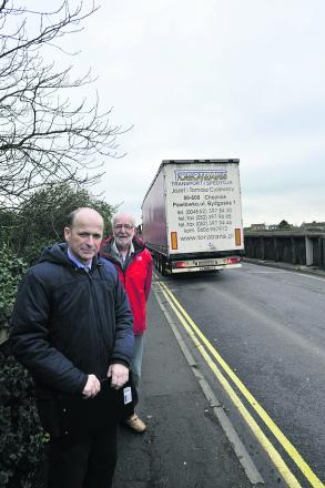 Cllr David Jenkins, front, and Primmers Place resident Clive Sutterly on Station Road railway bridge