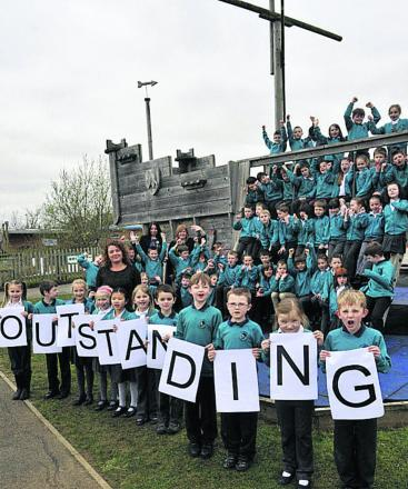 Headteacher Lyssy Bolton with Year 3 pupils at The Mead Community Primary School which is celebrating its 'outstanding' OFSTED report                                                Photo: Glenn Phillips (49247)