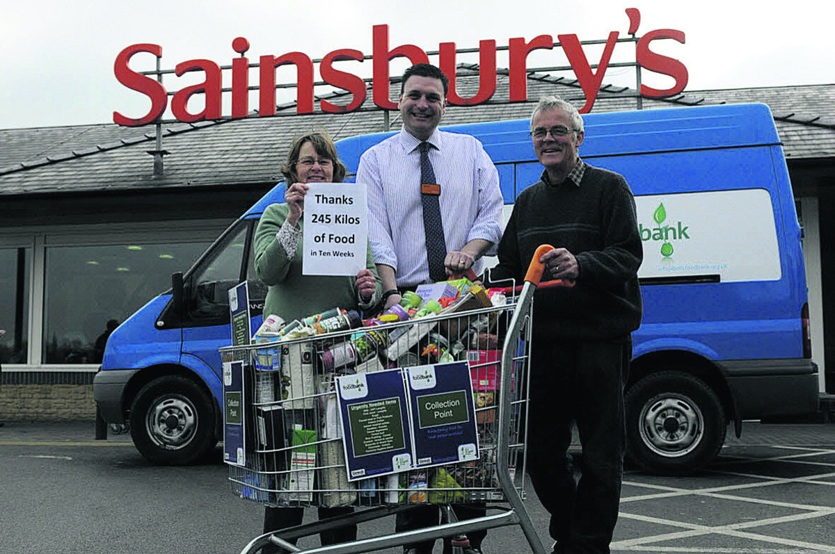 Tricia and Rob Munday each side of Sainsbury's store manager Darren Clare at Bradford on Avon. Shoppers donated 245kg of food stuffs for Bath Food Bank in ten weeks this spring