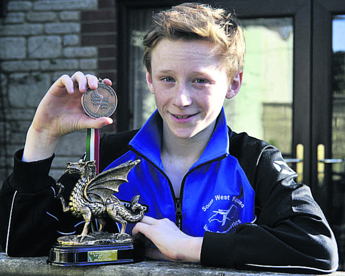 Cameron Sinden shows off the medal and trophy he won at the Welsh Artistic Championships earlier this month