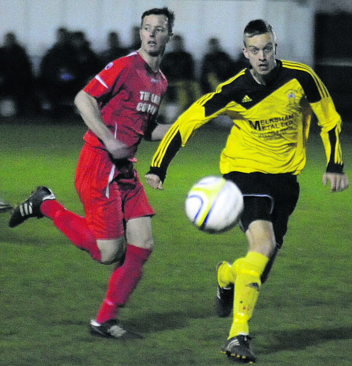 Melksham's hat-trick hero Gary Higdon (yellow) chases down possession during Tuesday night's semi-final