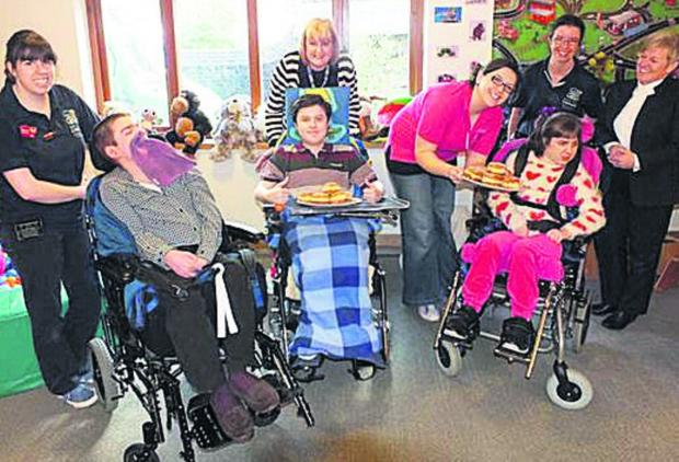 Wiltshire Times: Staff and children at Naomi House hospice, which has been helped by Doughnut Week donations