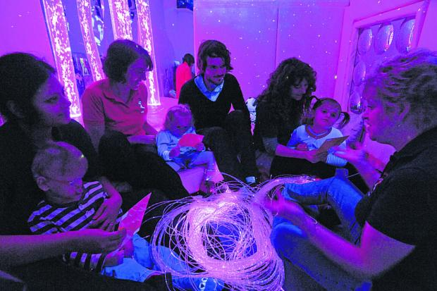 Reporter Craig Jones sits in on a sensory room session with, from left, Shrutai Kumar with Liam Collins, Judy Hennesy  with Mia Blaxall, Cally Pocock with Lydia Wadds, and session leader Gill Williams