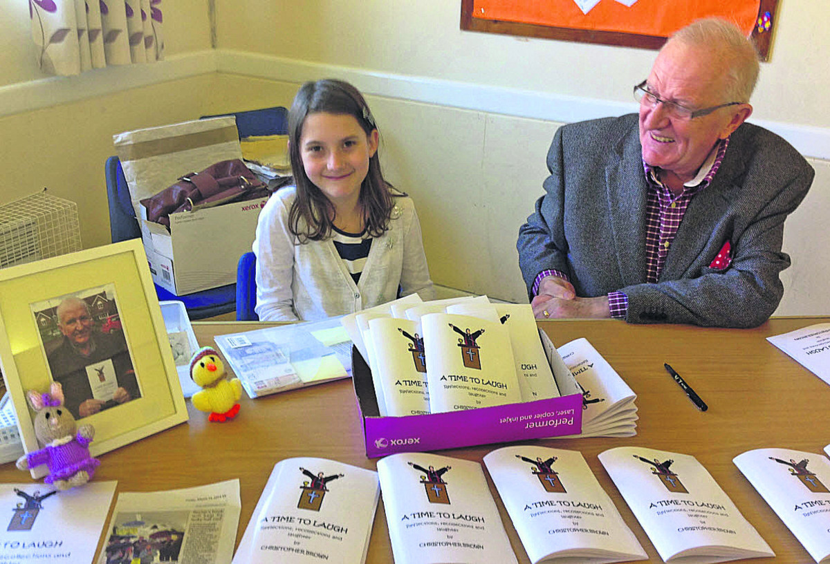Chris Brown and his granddaughter Lucy at the sale of books for the St John's Church Hall roof repair fund, Trowbridge