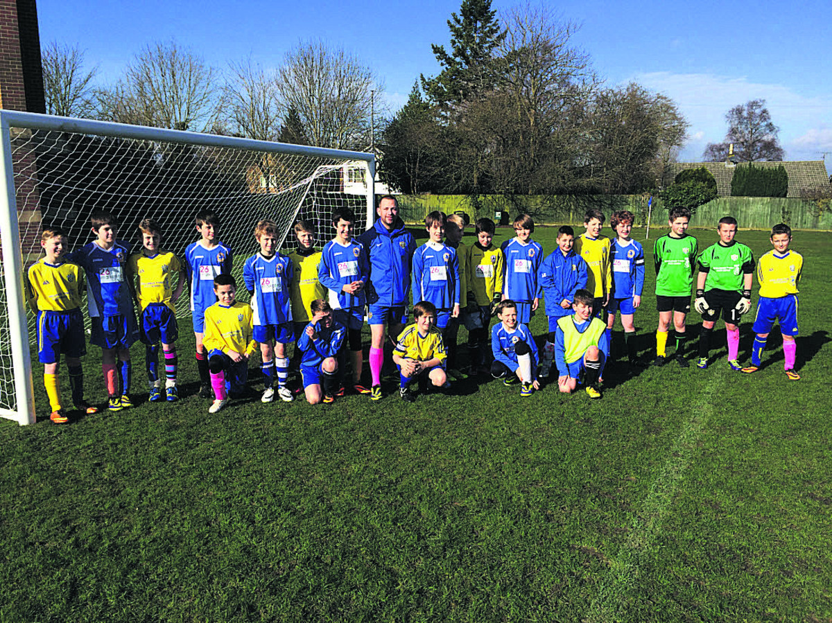 Dilton Rovers and Larkhall U11s football teams recently wore odd socks during a special match to raise funds for the Breast Cancer Care charity
