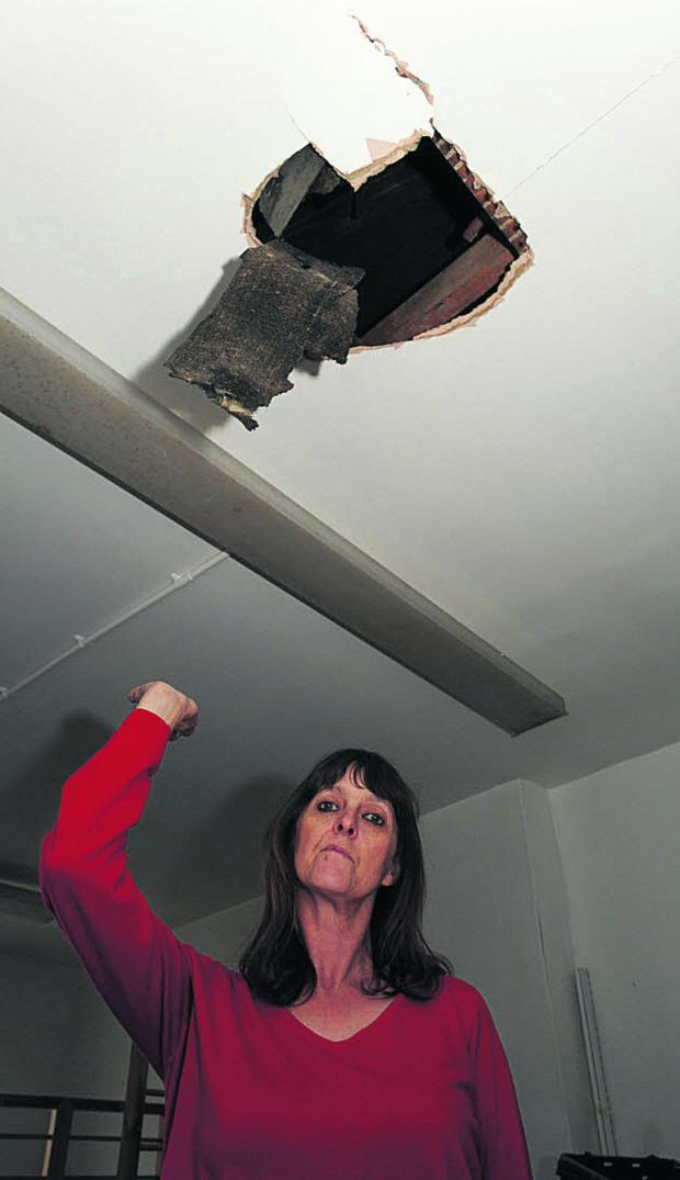 Wiltshire Times: Age UK sales assistant Caroline Dutch shows some of the damage caused during the break-in