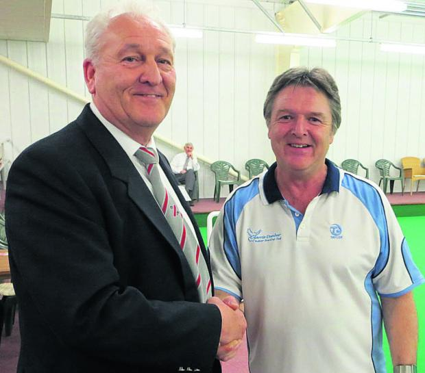 Keith Bailey is congratulated by North Wilts chairman Dave Alford after his tournament victory