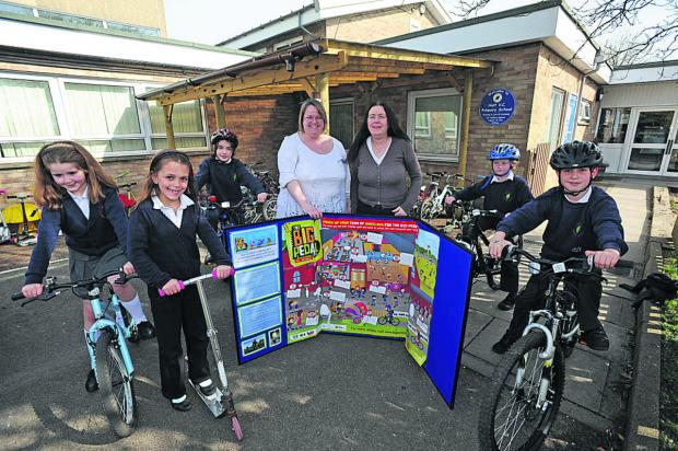 Holt Primary School pupils Lilly, Lucy, Lia, Tom and Matthew with staff member Denise Butterworth and head Margaret Harnden