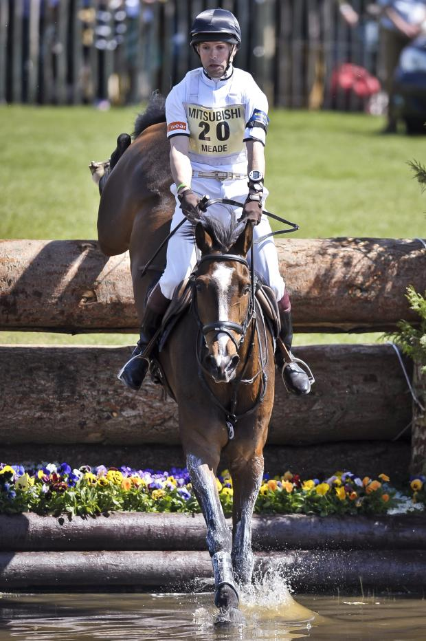 Wiltshire Times: Harry Meade on Wild Lone jumps the lake in the cross-country at last year's Badminton Horse Trials