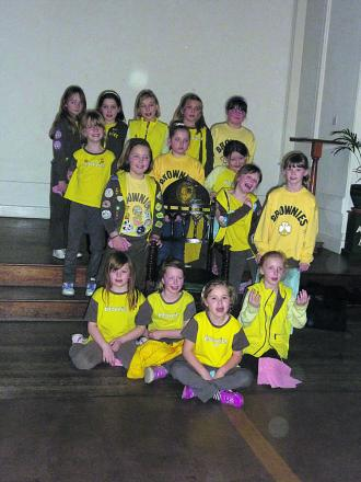 1st Westbury Brownies with the mayor's chair at the Laverton, gleaming after they gave it a good polish