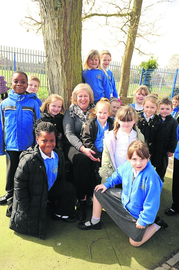 Wiltshire Times: Jan Ball and pupils at Westbury Infants' School
