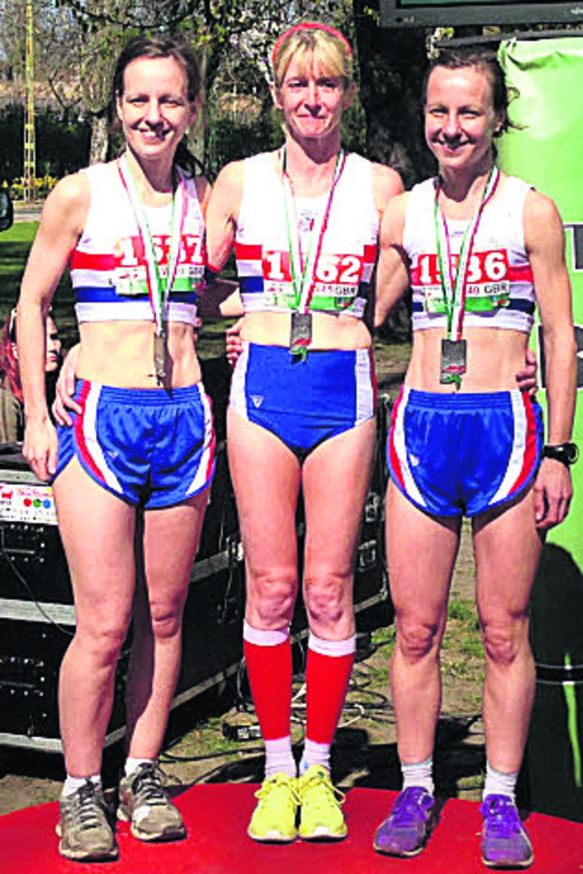 Fiona Price (centre) celebrates team silver with twins Sian and Lisa Finlay