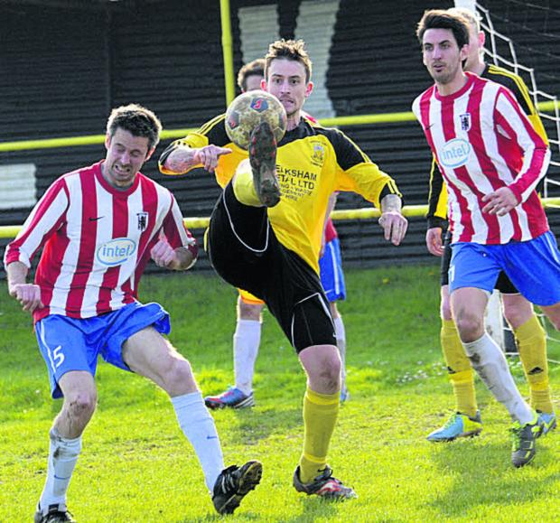 Melksham's Gary Perrott gets his toe to the ball in the Intel penalty area last weekend
