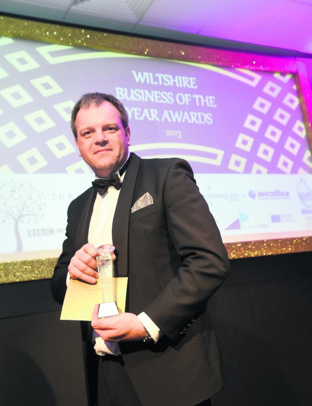 Wiltshire Times: Pebley Beach MD Dominic Threlfall with the award for excellence