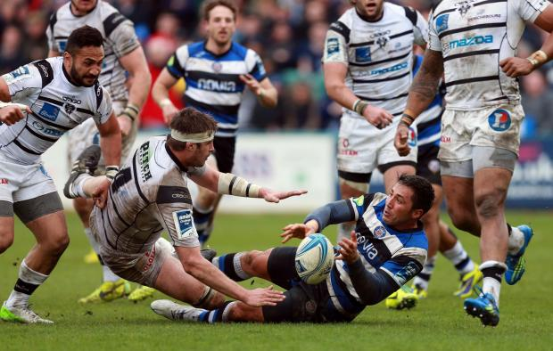 Wiltshire Times: Gavin Henson is tackled during today's quarter final
