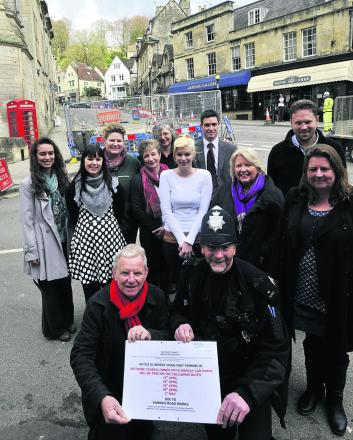 Mayor John Potter, PC Martin Annetts and local traders welcome the news that there will be free parking because of roadworks