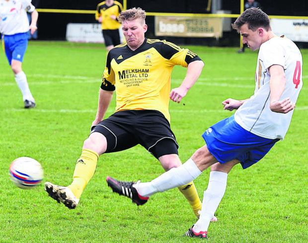 Melksham's Ben Thomson flies into a challenge during Saturday's goalless draw against Willand Rovers Photo: