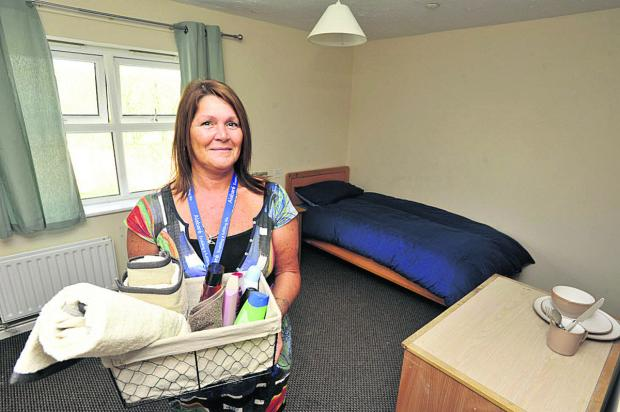 Andrea Wood, manager of the Alabaré hostel in Hilperton, in one of the charity's rooms for vulnerable youngsters