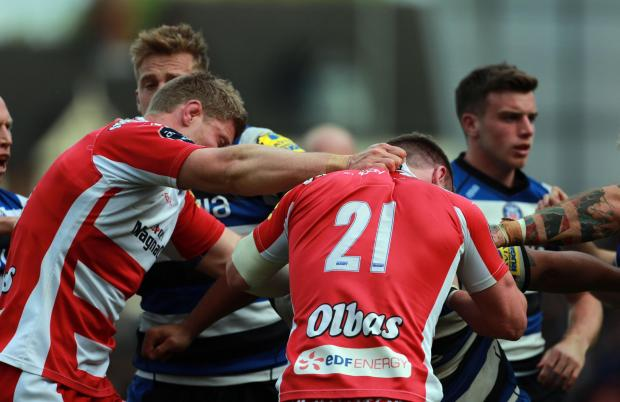 Fighting breaks out between Gloucester and Bath players after the award of Bath's penalty try
