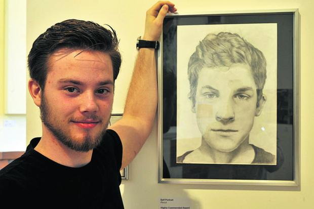 18-year-old Artur Pogorzelski of Trowbridge with his prizewinning artwork on show at the Pound Arts Young Open Exhibition