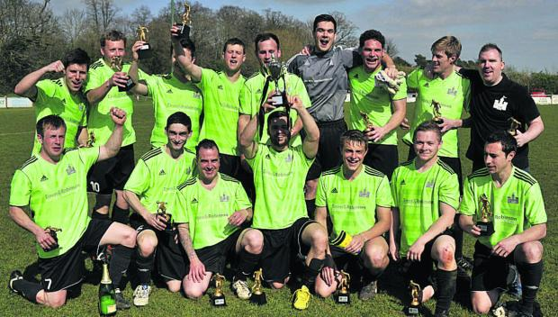 The Castle FC celebrate their WG Parr Trophy win