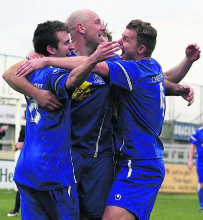 Goalscorer James Guthrie (left) takes the congratulations of Alan Griffin and Bryan Smith after putting Chippenham Town 2-0 up against Banbury United last weekend
