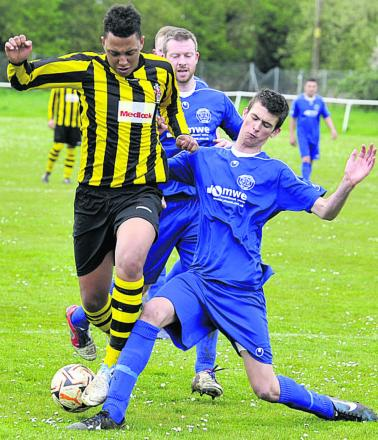Trowbridge Town's Otis Young is challenged during last weekend's clash with FC Chippenham Youth