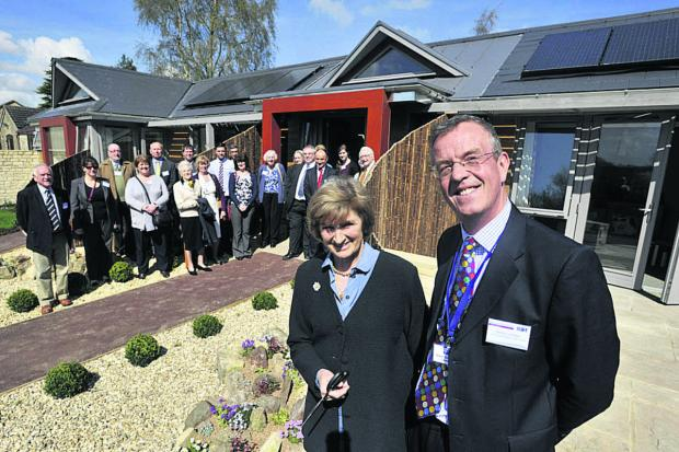 Dorothy House Hospice chairman Simon Coombe with Miranda, Duchess of Beaufort, who opened the new community lodges there on Friday last week                                                                                                            Photo:
