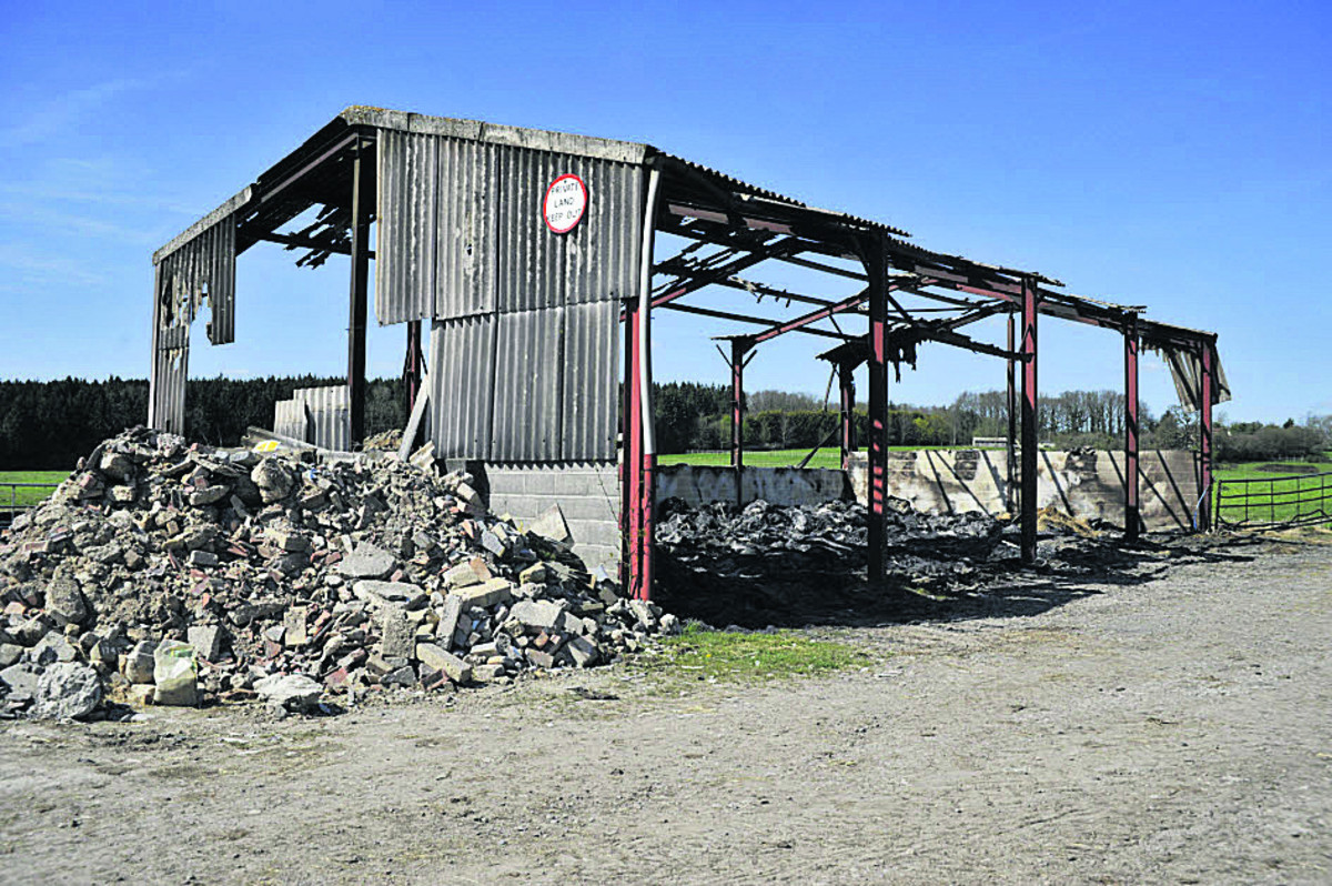 The burnt out frame of the barn in Warminster Photo: Glenn Phillips