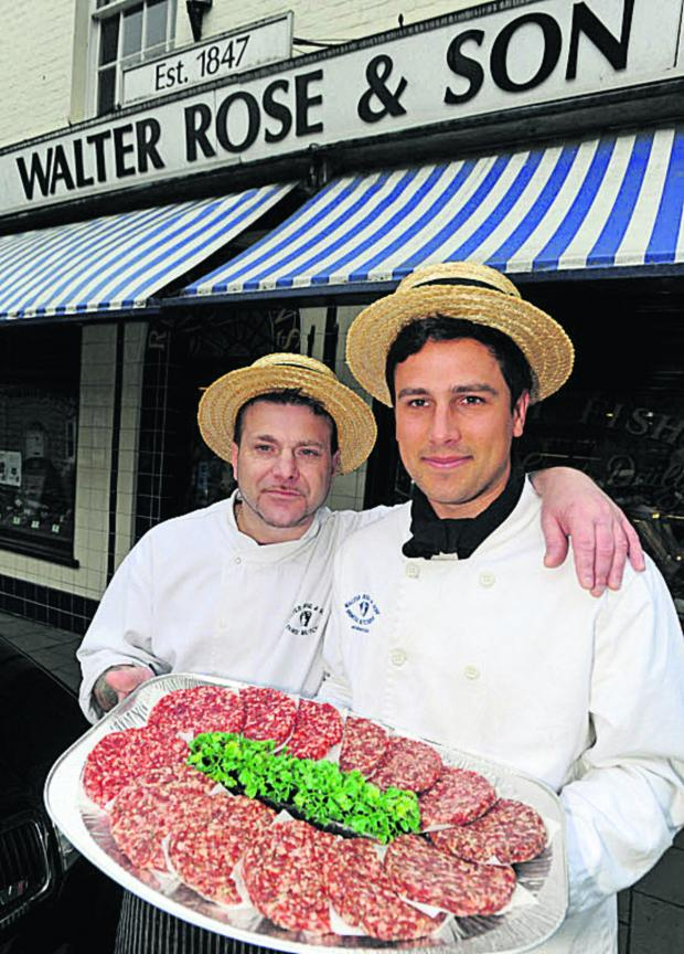 Wiltshire Times: Paul Gilroy and Jack Cook, of Walter Rose & Son, with burgers which got to the 2012 finals of the England's Best Burger competition