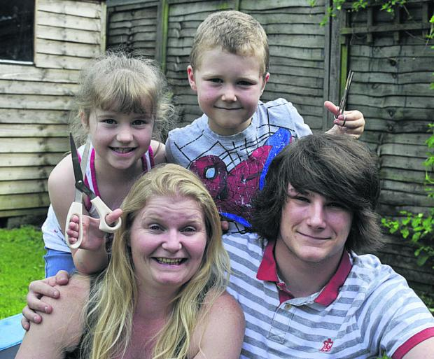 Abbie Wheeler and her eldest son Jean-Luc with Sam, who has epilepsy, and his sister Danielle