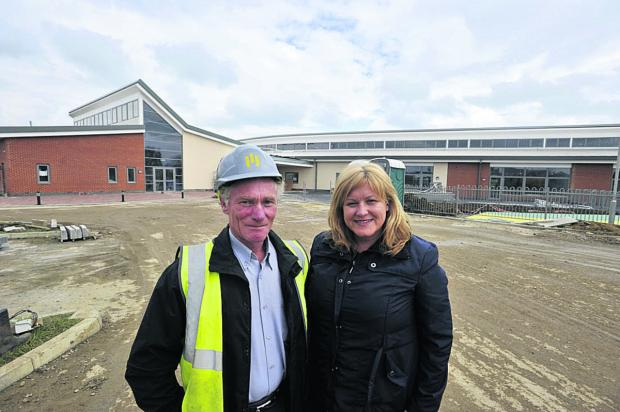 Headteacher Tracy Boulton with construction site manager Mike Gough at Trowbridge school Castle Mead Primary