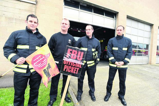 Manning the picket line outside Chippenham Fire Station in May were Watch Manager Paul Hanlon and firefighters Rob Kymoch, Colin Tailby and Paul Peche