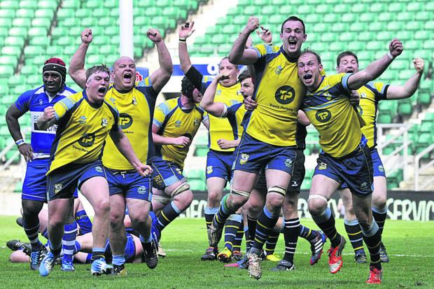 Wiltshire Times: Trowbridge's players start the celebration at the final whistle at Twickenham