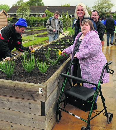 Pauline Joad, right, with carer Emma Smith and Scott Aylesbury at work on the raised bed. Picture: Trevor Porter (48728)