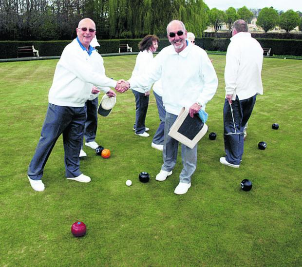 Secretary Derrick Hunt, left, and groundsman Morris Hughes, right, at the Bradford Bowls Club open day.                Photo: Richard Clarke