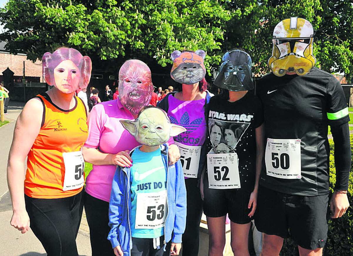 Behind the masks are Joanne Gillespie, Sophie Murray with Jake, Lauren, Leanne and Richard Roberts